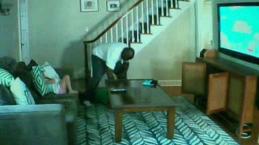 Still-shot photos taken from the nanny cam which show the unidentified ...